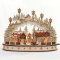 Schwibbogen Stadt verschneit mit bewegtem Weihnachtsbaum